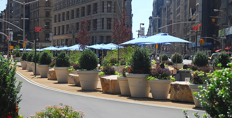 Experimental carriageway change -- planters, reallocation of space etc (NYC)