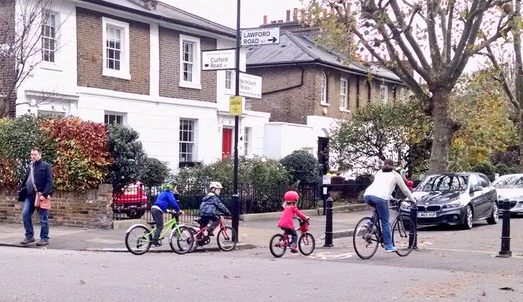 Pedestrians and child cyclists move easily through filtered streets